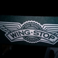 Photo taken at Wingstop by Tania T. on 4/27/2012
