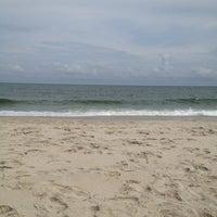 Photo taken at 83rd Street Beach by Sara M. on 8/1/2012