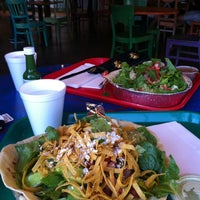 Photo taken at Cafe Rio Mexican Grill by D.K. J. on 4/11/2012