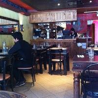 Photo taken at Lola Rosa Café by Betty E. on 5/6/2012