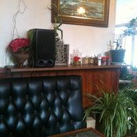 Photo taken at Café de La Poste by Jiris K. on 3/18/2012