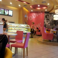 Photo taken at Dunkin Donuts @ Golden Central Tower by Michael M. on 6/16/2012