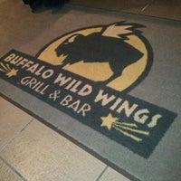 Photo taken at Buffalo Wild Wings by Dustin J. on 4/11/2012