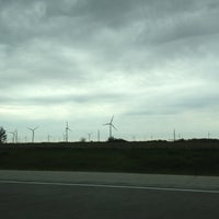 Photo taken at Windmill farm by Katie R. on 5/12/2012