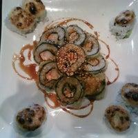 Photo taken at Sushi Garden by Karena R. on 3/3/2012