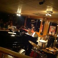 Photo taken at La Copa de Champagne Piano Bar by Rodrigo D. on 8/19/2012