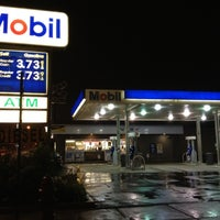 Photo taken at Mobil by Dave H. on 6/5/2012