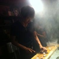 Photo taken at 初花一家 by Rikiya Y. on 8/4/2012