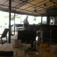 Photo taken at Shula's on the Beach by Vladimir I. on 6/25/2012