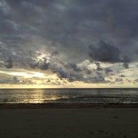 Photo taken at Layang-layangan Beach by Sabri J. on 7/13/2012
