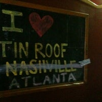 Photo taken at Tin Roof Cantina by Erik L. on 8/18/2012