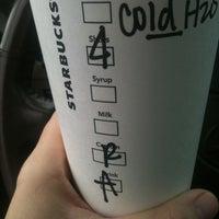 Photo taken at Starbucks by B W. on 3/3/2012