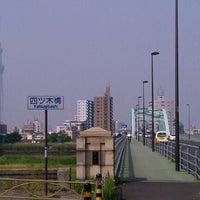 Photo taken at 四つ木橋 by Hiroyuki Y. on 6/1/2012