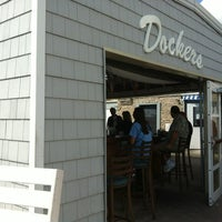 Photo taken at Dockers Waterfront Restaurant & Bar by Carina D. on 9/8/2012