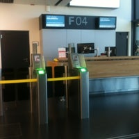 Photo taken at Gate F04 by Andrea C. on 7/23/2012