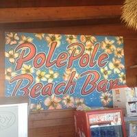 Photo taken at Pole Pole Beach by MIRIAM T. on 6/2/2012