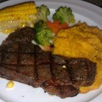 Photo taken at Amigo Grill & Restaurant by Lee K. on 6/2/2012