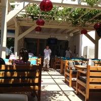 Photo taken at Buzz Beach Bar by Osman G. on 6/5/2012
