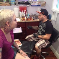 Photo taken at Salvation Tattoo Lounge by 💣Lex O. on 4/29/2012