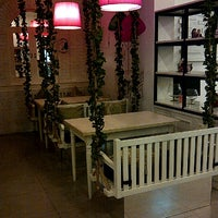 Photo taken at DE CAFÉ Resto & Delicatessen by Febryan G. on 8/13/2012