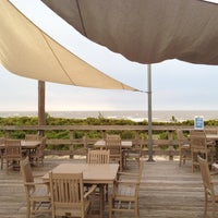 Photo taken at Fins On The Beach by Tim B. on 5/22/2012
