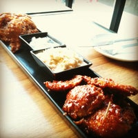 Photo taken at BonChon Chicken by Tiny M. on 7/15/2012