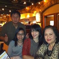 Photo taken at Romano's Macaroni Grill by Ellen L. on 4/28/2012