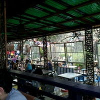 Photo taken at Spider House Patio Bar & Cafe by Edgar S. on 3/13/2012