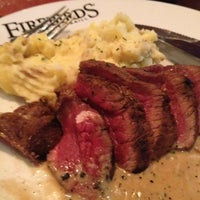 Photo taken at Firebirds Wood Fired Grill by Vicki B. on 7/29/2012