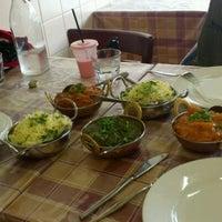 Photo taken at Tara's Cafe & Indian Restaurant by Yvonne V. on 4/6/2012