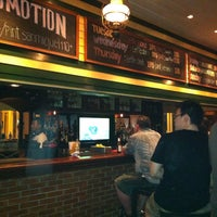 Photo taken at Mulligan's Irish Bar by Arisa I. on 4/14/2012