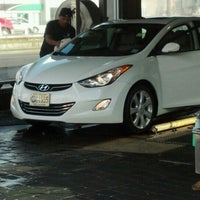 Photo taken at Super Car Wash & Quick Lube by Dennis O. on 6/8/2012