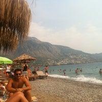 Photo taken at ammos beach bar by Dionysios X. on 8/8/2012