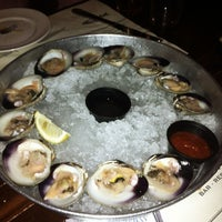 Photo taken at Doc Magrogan's Oyster House by Lulu X. on 5/4/2012