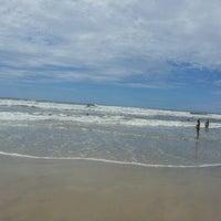 Photo taken at Praia de Imbé by Elena S. on 2/29/2012