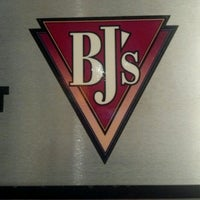 Photo taken at BJ's Restaurant and Brewhouse by Lauren A. on 8/3/2012
