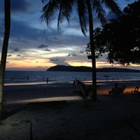 Photo taken at Pantai Cenang (Beach) by DyLa R. on 7/13/2012