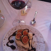 Photo taken at Romina Trattoria e Pizza by Jessica D. on 3/15/2012