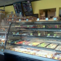 Photo taken at Quack's 43rd St Bakery by Samantha G. on 8/11/2012