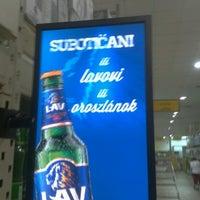 Photo taken at Trgopromet Supermarket 024 by Péter L. on 7/30/2012