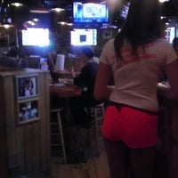 Photo taken at Hooters by Lauren K. on 8/26/2012