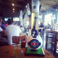 Photo taken at Ojos Locos Sports Cantina by Tricia G. on 7/15/2012