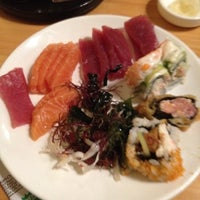 Photo taken at Kome Japanese Seafood & Grill by Angela W. on 5/10/2012