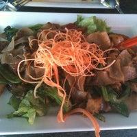 Photo taken at Mango Thai Cuisine by Tomomo N. on 2/29/2012