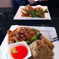 Photo taken at Sweet Ginger Asian Bistro & Sushi by Adam C. on 2/18/2012