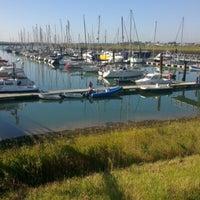 Photo taken at Burnham Yacht Harbour by Luke M. on 9/9/2012