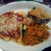 Photo taken at Carlos' Cantina by Ian W. on 4/24/2012