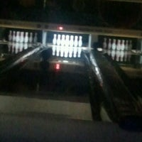 Photo taken at Highland Park Bowl Inc. by Hannah M. on 4/15/2012