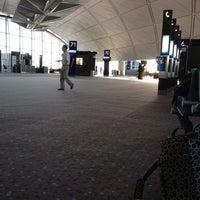 Photo taken at Gate 70 by Simon L. on 7/1/2012