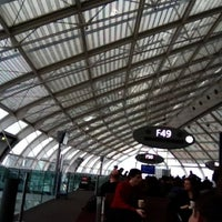 Photo taken at Gate F49 by Pisco Hacienda del A. on 3/11/2012